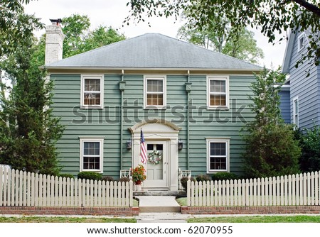 House with Picket Fence - stock photo