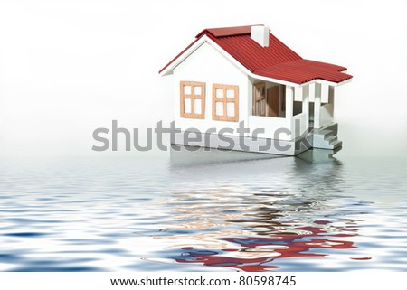 house with red roof with reflection in water