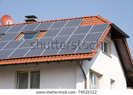 House with solar energy - stock photo