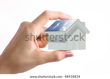 House with solar panel in the woman hand - stock photo
