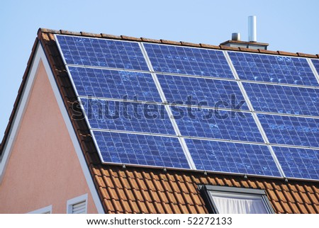 House with solar panels for renewable energy production.