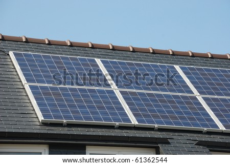 House with solar panels on roof - stock photo
