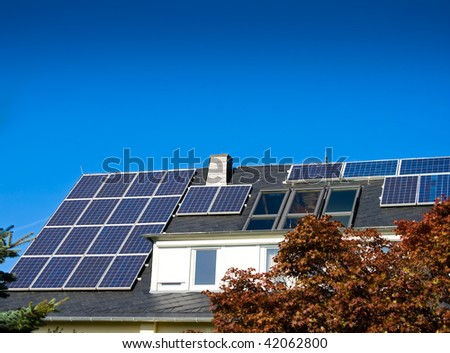 House with solar (photovoltaic) panels - stock photo