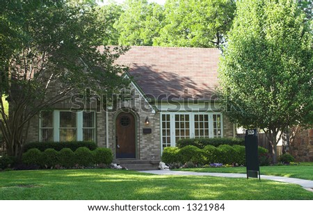 house with sold sign in yard; space on sign is blank for the addition of text - stock photo