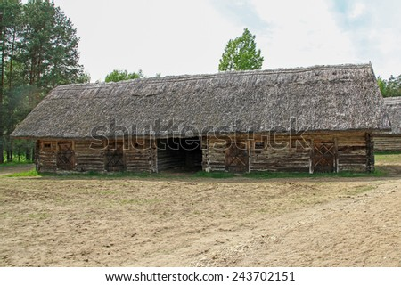 house with thatched roof - stock photo