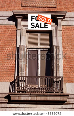 House with window, balcony and a sold sign