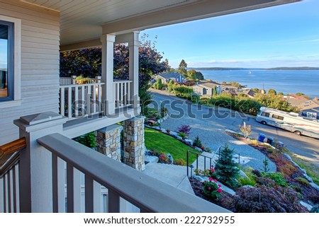 House with wraparound walkout deck. View of puget sound and driveway, Tacoma, WA - stock photo