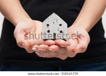 House Wooden in both hands - stock photo
