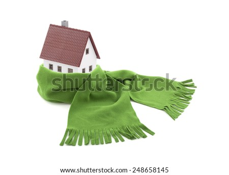 House wrapped in a scarf isolated on white - stock photo