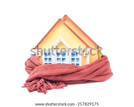 House wrapped in a scarf isolated on white.  - stock photo