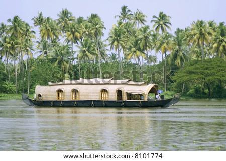 houseboat cruise through the backwaters, kerala, india - stock photo