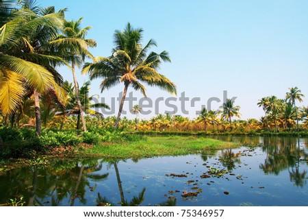 Houseboat tour through the backwaters of Kerala, India - stock photo