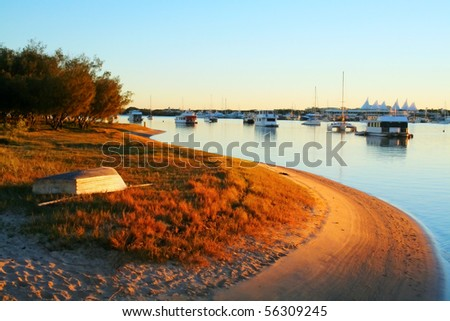 Houseboats and yachts moored in the Broadwater Gold Coast Australia on a golden morning. - stock photo
