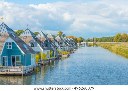 Houseboats in a canal at fall