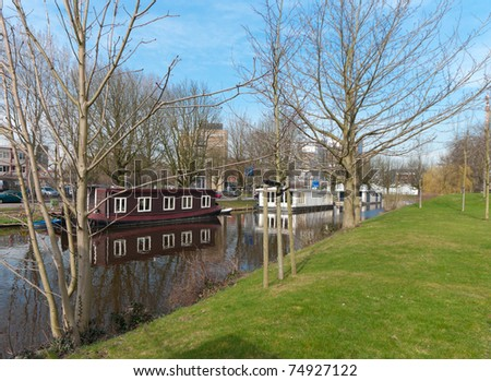 houseboats in a canal in Leiden, Netherlands