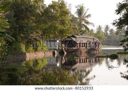 Houseboats in Kerela Backwaters, India - stock photo