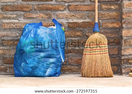 Household Used Broom For Floor Dust Cleaning and Blue Plastic Garbage Bag, Horizontal - stock photo