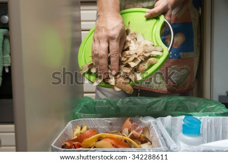 Household waste sorting and recycling kitchen bins in the drawer. Collecting food leftovers for composting. Environmentally responsible behavior, ecology concept. - stock photo