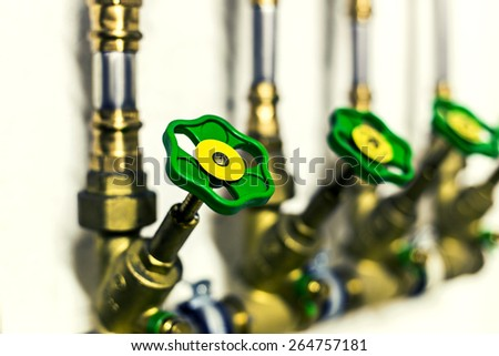 Household water pipe valve close up. Water concept.Selective focus, toned. - stock photo
