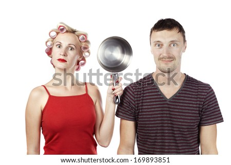 Household woman in red topic and rollers with pan and man against white background - stock photo