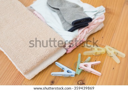 housekeeper folding towels & clothes - stock photo