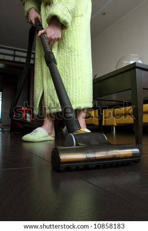 Housekeeping: cleaning the floor - stock photo