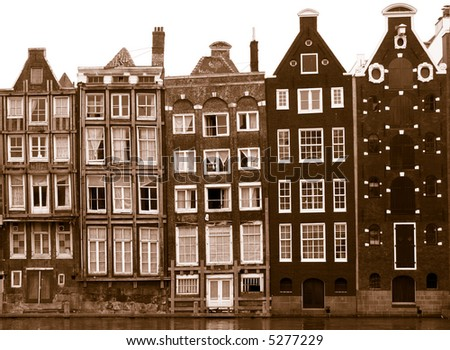 houses along an Amsterdam canal in sepia