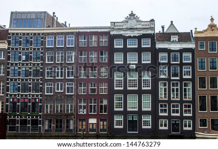 Houses along the canals of Amsterdam - stock photo
