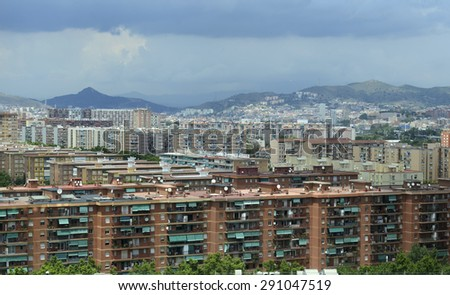 Houses and apartments in Suburban sprawl of the City of coastal Barcelona, Spain - stock photo