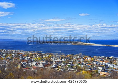 Houses and Atlantic Ocean shore at Sandy Hook with a view of NYC. View from light house. Sandy Hook is in New Jersey, USA - stock photo