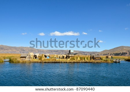 Houses and Boats Made of Reed on Uros Floating Island on Highest Navigable Lake in the World -  Titicaca - stock photo