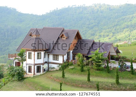 houses and green hills - stock photo