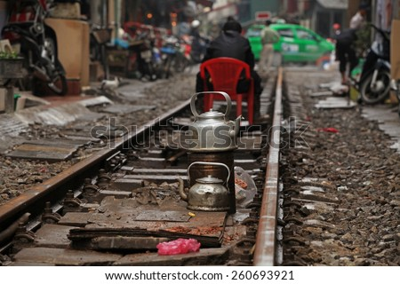 Houses and life on railway track. Living on the side of railway in Hanoi, Vietnam.