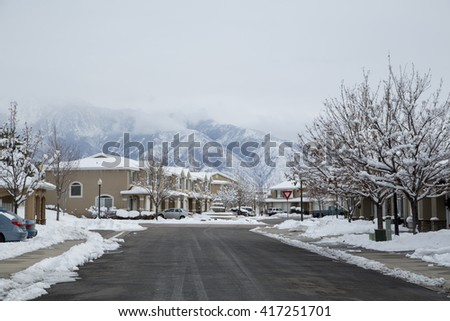 Houses and village covered by snow in winter  - stock photo
