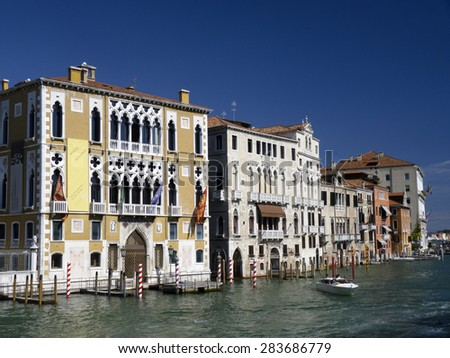 houses at Grand Canal in Venice Italy. The canale grande is the main transportation canal in Venice. - stock photo