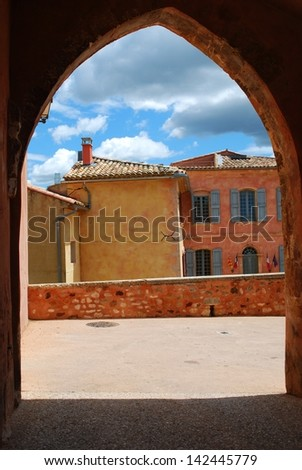 Houses behind an arc in ocher village of Roussillon, Provence, France