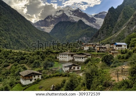 Houses below Meili mountain in Yubeng, Yunnan, China