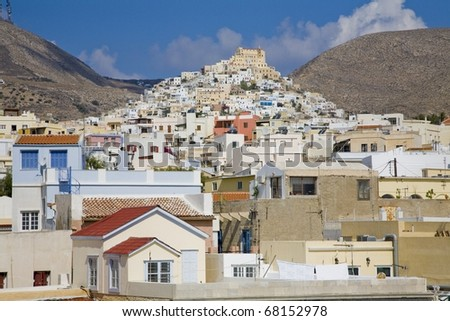 Houses built into the side of the mountain  in Santorini Greece - stock photo