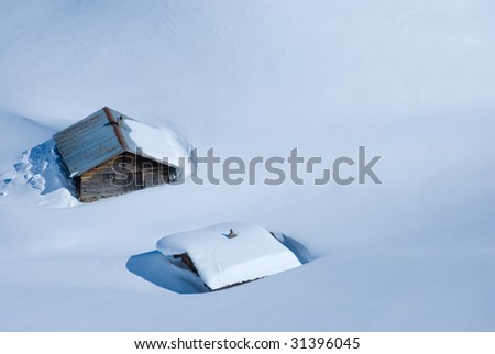Houses covered with snow - stock photo