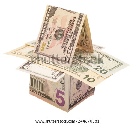Houses from dollars banknotes. Isolated over white  - stock photo