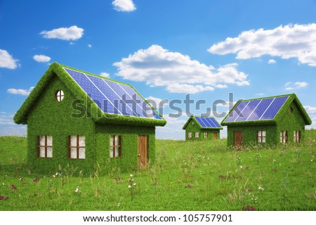houses from the grass with solar panels on the roof. - stock photo