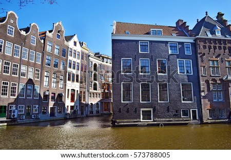 houses in front of the canals Amsterdam Holland