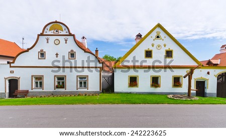 Houses in Holasovice - old Bohemian village on UNESCO heritage list - stock photo