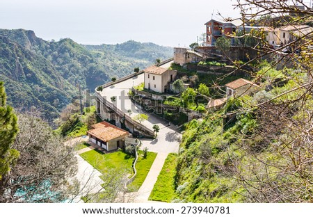 houses in mountain village Savoca in Sicily and sea on horizon, Italy - stock photo