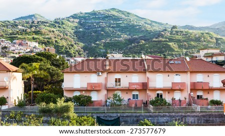 houses in town Gaggi in Sicily on green hills, Italy in spring day - stock photo