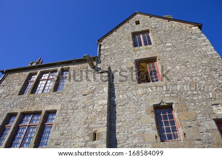 houses inside the mont saint michel in the north of france - stock photo