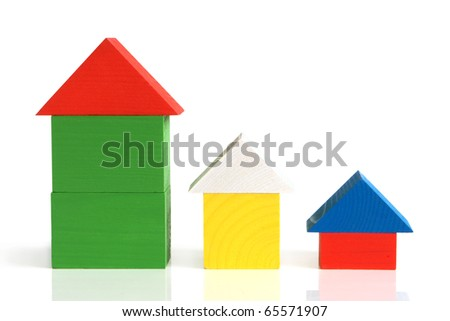 Houses made from children's wooden building blocks on a white background