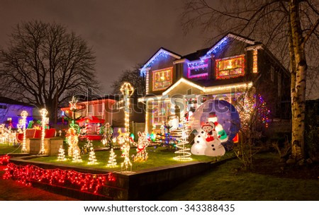 Houses, neighborhood decorated and lighted for Christmas and for New Year Eve . Night in Vancouver, Canada.