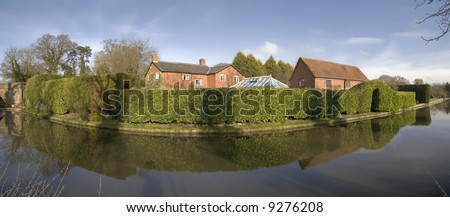 Houses next to canal or river.