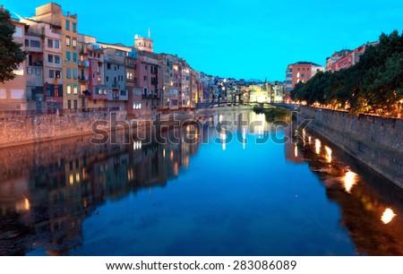 Houses of Girona reflecting in Onyar River - stock photo
